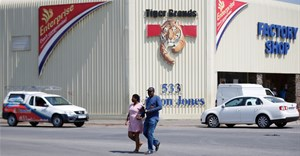 A couple leaves Tiger Brands factory shop in Germiston, Johannesburg, South Africa, 5 March 2018. Reuters/Siphiwe Sibeko