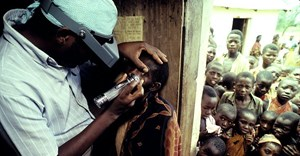 A health worker examines a child for signs of trachoma Joe McNally/Getty Images