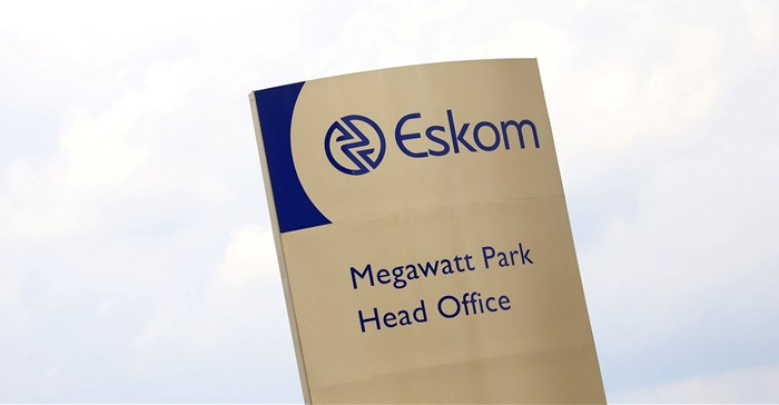 An Eskom logo is seen at the entrance of their head offices in Sunninghill, Sandton,file. Reuters/Siphiwe Sibeko