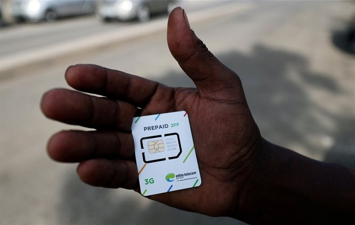 A customer holds a 3G prepaid sim card after buying the service from an Ethio-Telecom shop in Addis Ababa, Ethiopia, November 12, 2019. Reuters/Tiksa Negeri/File Photo