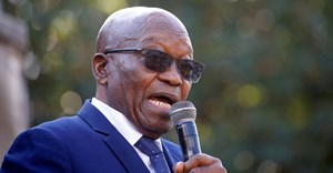 South Africa's former President Jacob Zuma, who faces fraud and corruption charges, speaks to supporters after appearing at the High Court in Pietermaritzburg, South Africa, 17 May, 2021. Reuters/Rogan Ward/File Photo