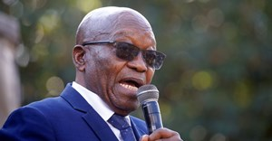 Former president Jacob Zuma, who faces fraud and corruption charges, speaks to supporters after appearing at the High Court in Pietermaritzburg, South Africa, 17 May 2021. Reuters/Rogan Ward/File Photo