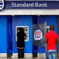 Customers at an ATM at a branch of South Africa's Standard Bank in Cape Town, 15 March, 2016. Reuters/Mike Hutchings/File Photo