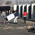 Demonstrators in Katlehong loot a shopping centre during protests following the imprisonment of former President Jacob Zuma. Source: Reuters/Siphiwe Sibeko