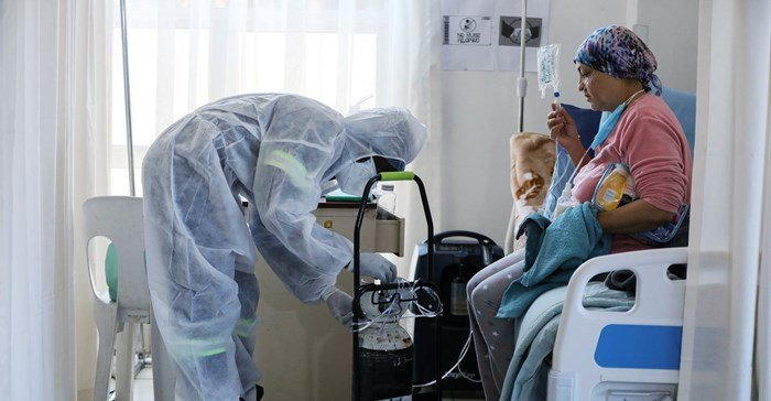 A healthcare worker assists a patient being treated at a makeshift hospital run by charity organisation The Gift of the Givers, during the coronavirus disease (Covid-19) outbreak in Johannesburg, South Africa, July 11, 2021. Reuters/ Sumaya Hisham