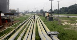 A woman walks over pipelines crisscrossing Ogoniland in Rivers State, Nigeria 18 September, 2020. Reuters/Afolabi Sotunde//File Photo