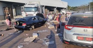 Demonstrators loot the Ayoba Cold Store as protests continue, following imprisonment of former South Africa President Jacob Zuma, in Chesterville, Durban, KwaZulu-Natal, South Africa 12 July 2021, in this still image obtained from social media video. Siphiwe Emacous Moyo Snr/via Reuters