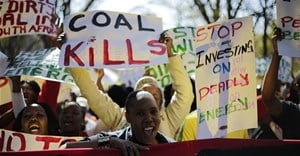 Demonstrators in Johannesburg march against environmental damage done by coal. Photo by Cornell Tukiri/Anadolu Agency/Getty Images