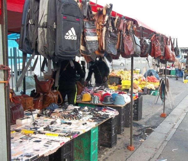 """There were no customers at Ali Dop's leather bag and clothing stall. """"I have been sitting here for two hours, but not a single person has even asked how much,"""" he said."""