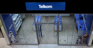 A shopper walks past a Telkom shop at a mall in Johannesburg, file. REUTERS/Siphiwe Sibeko