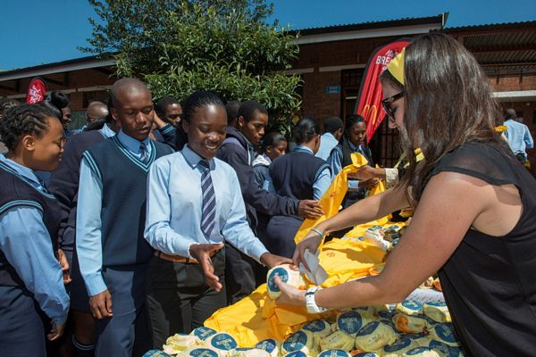 """Phefeni Senior Secodary School learners receiving McDonalds McMuffins breakfast"""