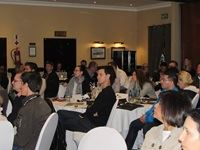 Group shot of guests listening to a guest speaker