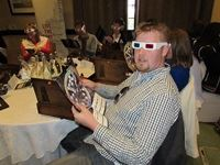Matt Landon (Initiative Media) looks at the Partner wheel (included in the gift) l through her 3D glasses