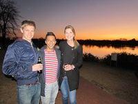 Charl Redelinghuys (PHD - Cape Town), Ricky Hendricks (Ogilvy) and Sue Glennie (Habari Media) enjoy a sundowner alongside the lake at Irene Country Lodge.