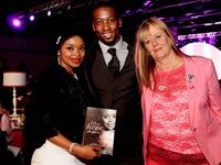 """Cancer survivor and the author of """"When Hope Whispers"""", Zoleka Mandela and her partner, Thierry Bashala. With the couple is the driving force and founder behind the PinkDrive initiative, Noelene Kotschan."""