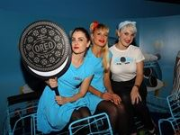 Oreo Roller girls posing with our oversized Oreo