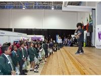 Emile Jansen from – Heal the Hood Project on stage, performing for the children attending the FutureMe - World of Work (WoW) festival.