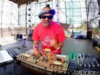 DJ Jazzy D on the decks on stage