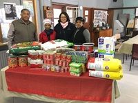 Cape Town Port Manager Mpumi Dweba (in red) with the leadership of the Douglas Murray Home Retreat and donations from port employees.