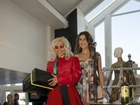Tracy-Lee Rossling collecting her prize from Taniya Miller of Carol Boyes