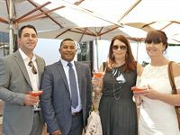 Angus Spurr Head of Operations Radisson Blu Waterfront with Concierge Yusuf Jinoo and Nina Tomlinson and Margaret Marx of Denny