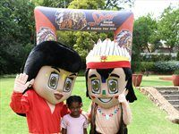 Spur Secret Tribe Chief Cook contestant with Spur mascots at Prue Leith Chefs Academy